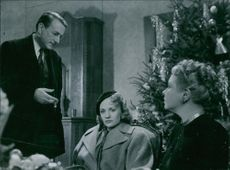 """Georg Funkquist, Gunn Wållgren and Marianne Löfgren in a scene from the film, """"Woman Without a Face"""". 1947."""
