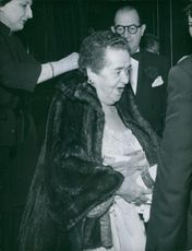 American gossip columnist and author Elsa Maxwell have stood around the people