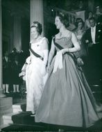 Queen Juliana of the Netherlands going down the stairs together with someone.
