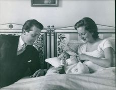 Albert II of Belgium with his wife and newborn baby.