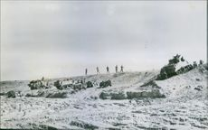 1943 A unit of American armored forces gathers behind a front line observation post preparing to launch the successful American counter attack at Kasserine Pass, Tunisia.