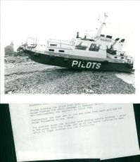 Pilot boat wading ashore dry-shod because of foggy weather and low visibility.  Taken - Circa 1979
