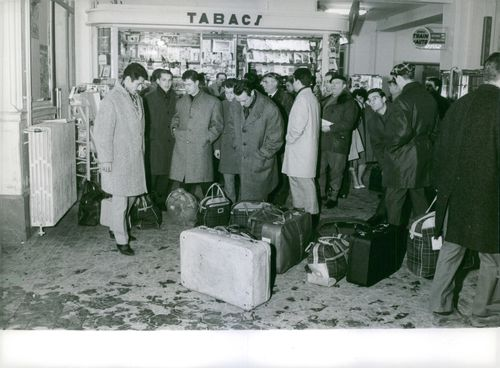 Gentlemen with their luggage.