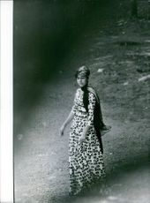 Photo of a woman standing.