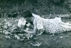 Horst Werner Buchholz lying on ground and doing romance with a woman.