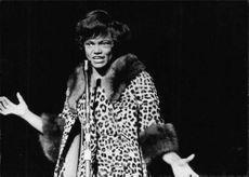 Eartha Kitt singing.
