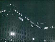 A night view of buildings. 1963