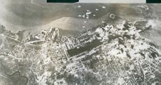 This aerial view of the German submarine base at St. Nazaire, France, was taken during an attack by American heavy bombers.