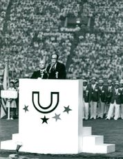 A leader speaking on a podium in the stadium, August 1967.