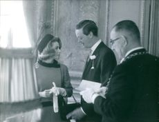 John Spencer-Churchill, 11th Duke of Marlborough, having a conversation with his bride Athina Onassis.