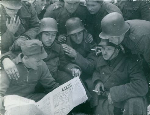 Finnish soldiers in Vyborg reading the Karjala  newspaper during the Finnish-Russian War 1939-40