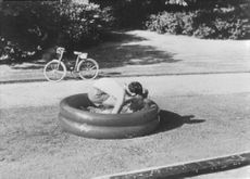 Brothers swimming in a small inflatable pool.  - 1968