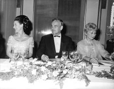 Princess Margaret sitting across a table.