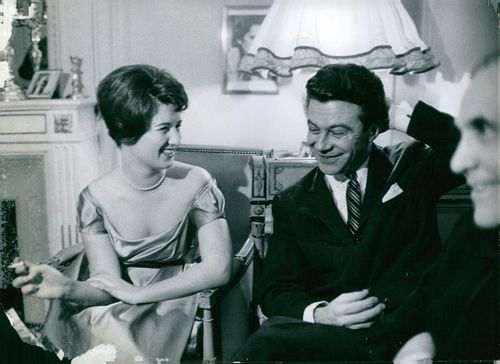 A man and a woman siting together while having a conversation.