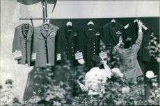 The uniforms of King Constantine are hung on the terrace for airing.