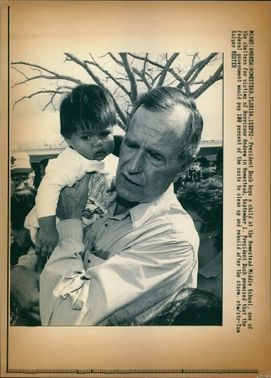George Walker Bush with a child.
