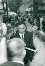 Man surrounded with people.