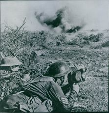 Soldier firing at the enemy during wartime.