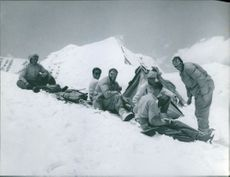 Mountain climbers called a break and built a tent on a snowy track.