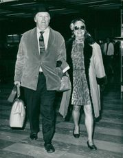 Ginger Rogers with husband at Heathrow Airport on his way to Boston