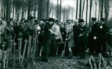 Albert II with other people in forest.