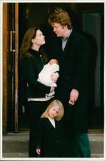 Earl Spencer and Lady Spencer with their son and daughter