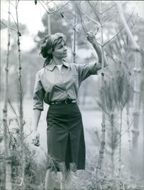 Woman looking branches in