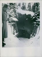 A cave in the forest while snowing during First World War, 1940.
