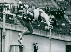 A photo of Japanse Athlete Hidehiko Tomizawa high jumping, 1972.