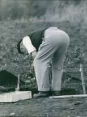 George VI looking at the soil.