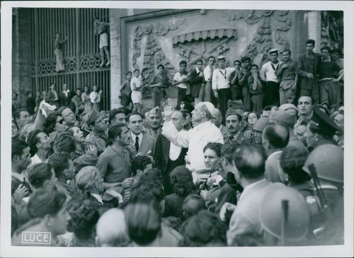 Holy father surrounded by people.