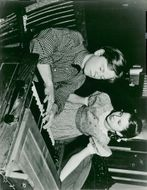 Mickey Rooney composes a new tune while Virginia Weidler watches during movie recording for Metro-Goldwyn-Mayer