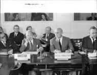 Yul Brynner sitting in a conference.