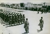 French Moroccan troops march in review.