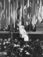 Pope Paul VI sitting on chair, addressing.
