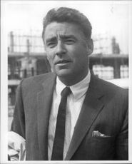 Portrait photography of actor Peter Lawford, taken at London Airport.