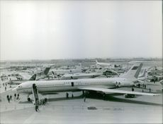 High angle view of airplanes in a busy airport.