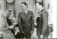 "Actors Jean Harlow, Dick Powell and Spencer Tracy in the movie ""The Lord of the Situation"""