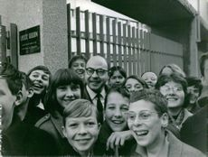 Jacques Borel posing for a camera with kids, 1965.