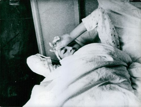 Rosa Dangubic laying on the bead with her face partially covered by her hand.
