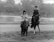Caroline Kennedy riding on horse.