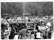 Princess Margaret going in a horse pulling chariot.