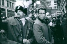 """A photo of Arnold Schwarzenegger as Howard Langston and Sinbad as Myron Larabee in the film """"Jingle All the Way"""". 1996."""