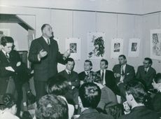 Pierre Marcilhacy giving speech for press reporters.
