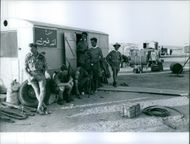 Soldiers siting in the camp while standing and relaxing in Lebanon.