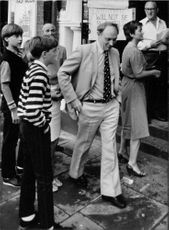 Neil Kinnock with his family in street.