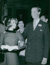 John Spencer-Churchill standing with his wife, looking at each other and smiling.