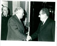 Dr. Henry Kissinger with harold wilson.