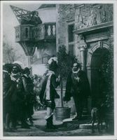A photo of a Danish nobleman Tycho Brahe standing in a conversation.