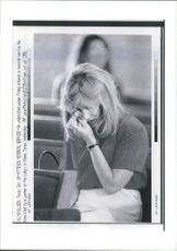 USA Texas Massacre: A woman weeps.